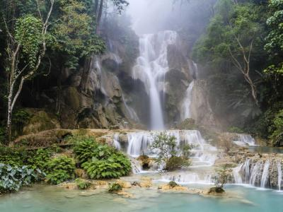 Luang Prabang, Laos. It's a tourist-y town literally surrounded by a jungle. What's not to love?